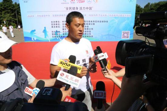 总裁判长陆阳在介绍赛事情况