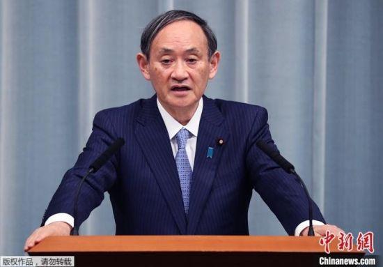 资料图:日本首相官菅义伟。